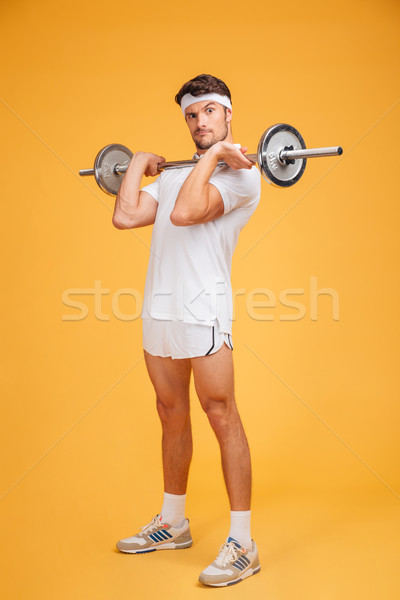 7226309_stock-photo-playful-young-sportsman-holding-barbell-and-making-funny-face