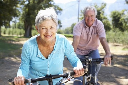 depositphotos_11885931-stock-photo-senior-couple-on-country-bike